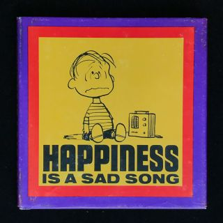 Happiness is a Sad Song. Charles M. Schulz